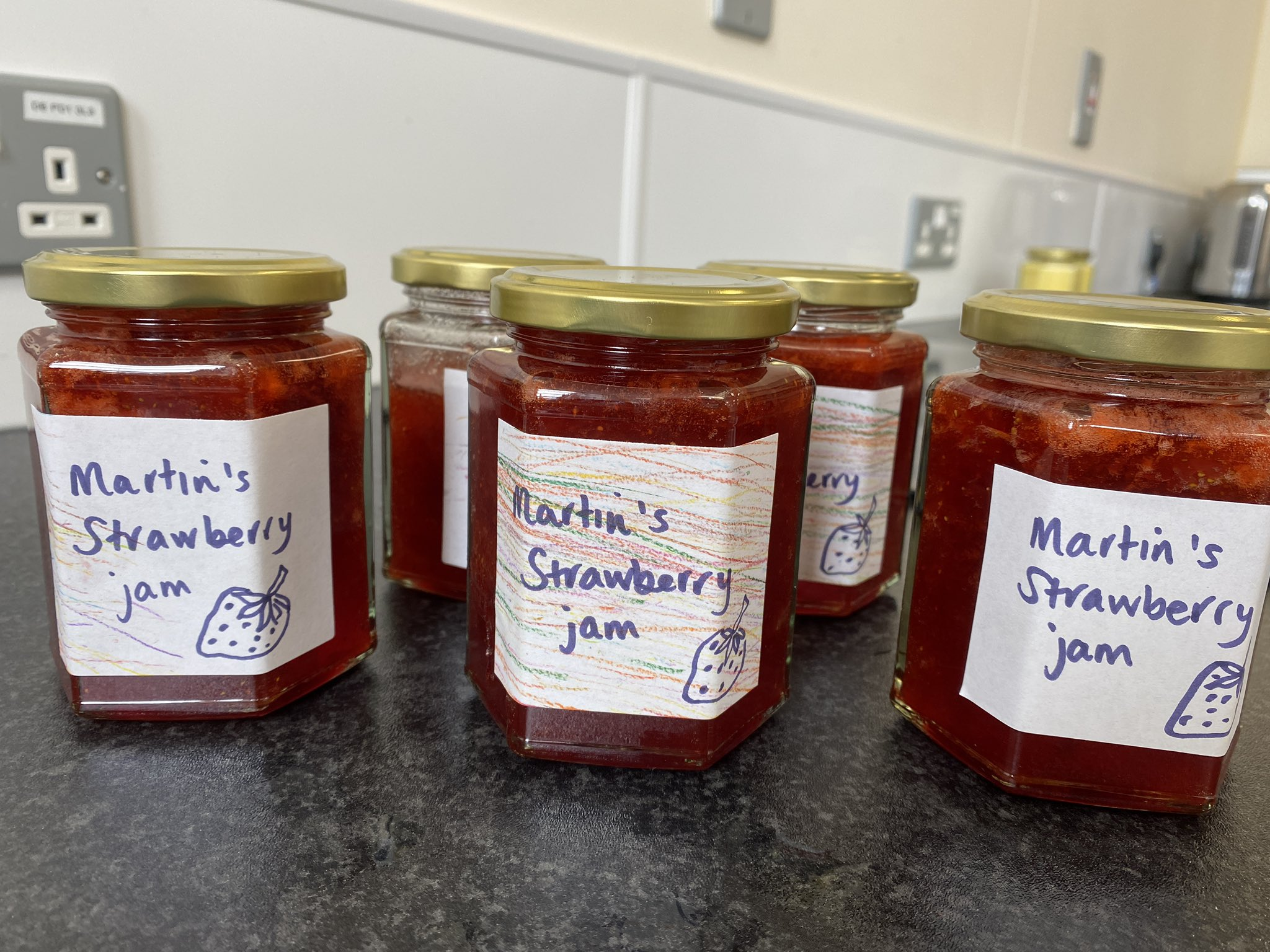 Jars of strawberry jam made and packaged by the learners